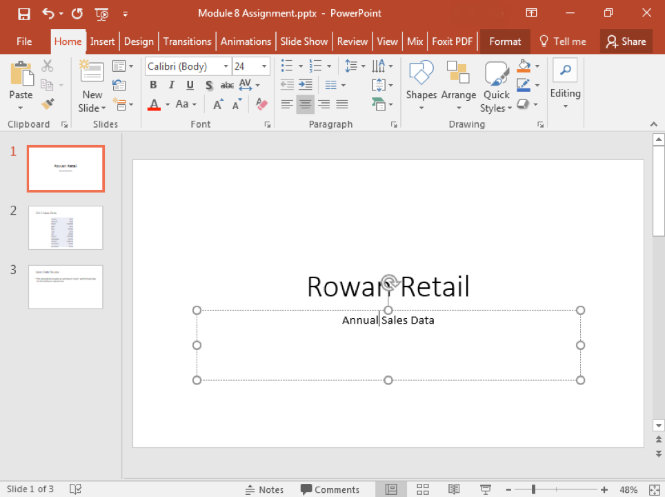 "A Microsoft Powerpoint deck is open with 3 slides created. It is open to the first slide in the deck and there is a text box where ""Annual Sales Data"" has been typed."