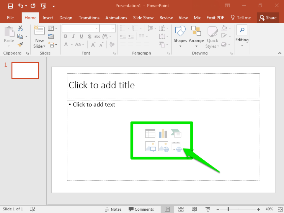 A blank Microsoft Powerpoint is open. The content box on the first slide is highlighted by a green box. There is a green arrow pointing to the video icon in the content box.