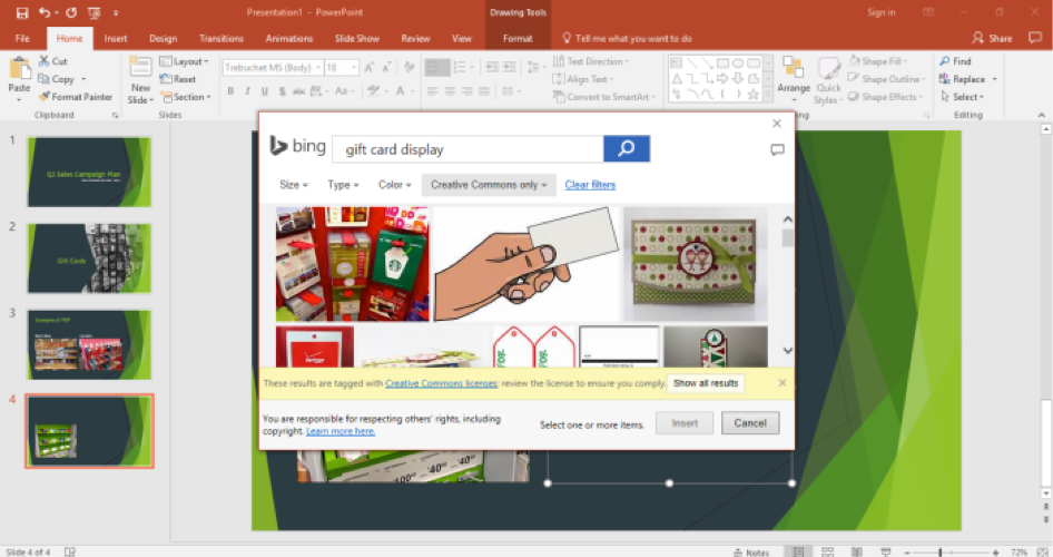 A Microsoft Powerpoint is open for a sales campaign. It is on the fourth slide of the powerpoint and a bing search for gift card display has been entered. The bing search is shown in front of the powerpoint.