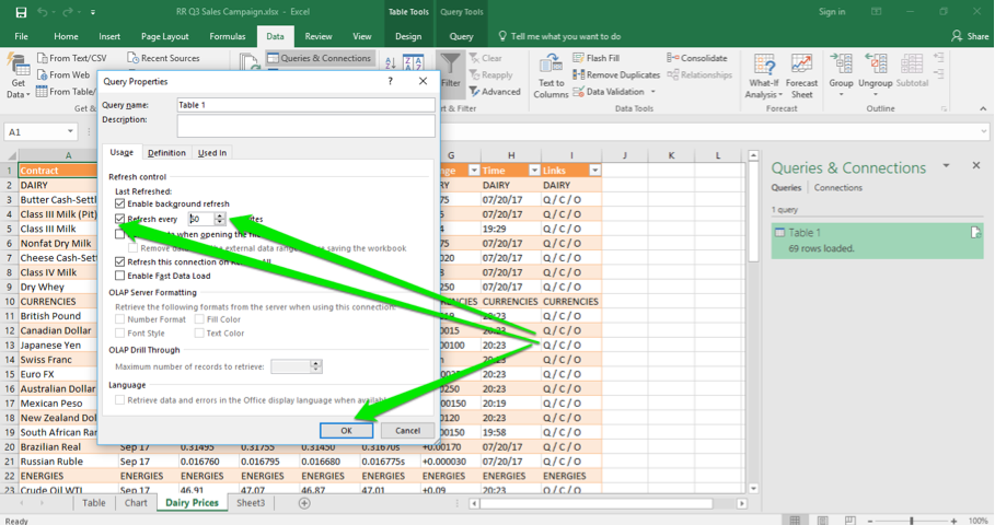 An excel sheet is open with the newly loaded data table inserted. The query properties dialog box is open and there are three green arrows displayed. The first one points at the option to set a time to refresh the table, the second one shows that the time has been set to 60 minutes and the third arrow shows that the ok button has been selected.