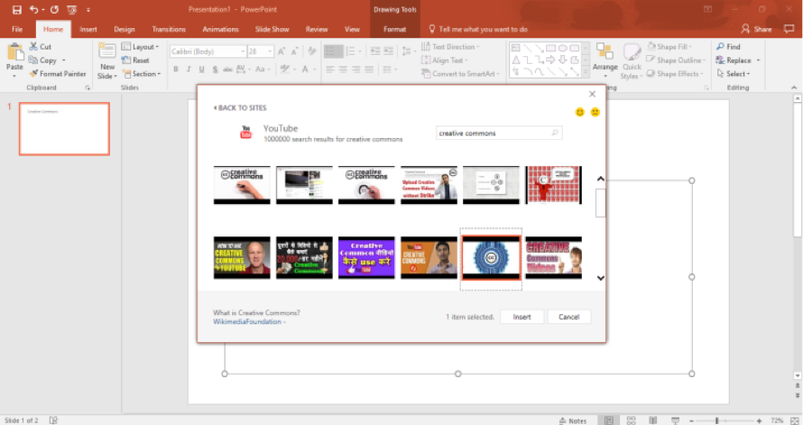 A Microsoft powerpoint is open. In the insert video dialog box results for creative commons videos are being displayed.