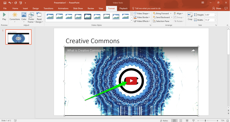 A Microsoft powerpoint is open. A video has been inserted and there is a green arrow pointing to the play button on the video.