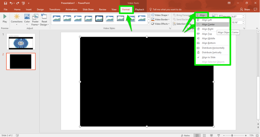 A Microsoft powerpoint is open. A video has been inserted. There are three green arrows on the slide, the first one is pointing at the format tab in the ribbon menu. The second is pointed at the align button and the third shows that the video is set to be aligned to the center.