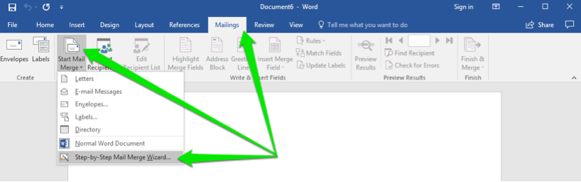 A blank Microsoft Word document is open. There are three green arrows on the document, the first arrow shows that the mailings tab in the ribbon menu has been selected. The second arrow is pointing at the start mail merge button and the third is pointing at the step by step mail merge wizard button.