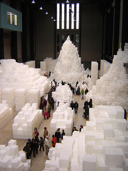 Photograph of art installation, which consists of 14,000 translucent, white polyethylene boxes stacked at varying heights.