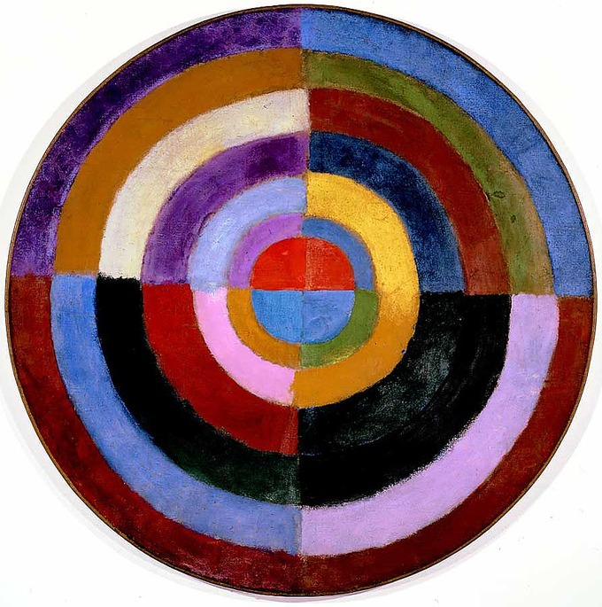 Abstract painting of circle resembling a target used for archery. The circle is dived into four equally sized segments painted in a variety of colors.