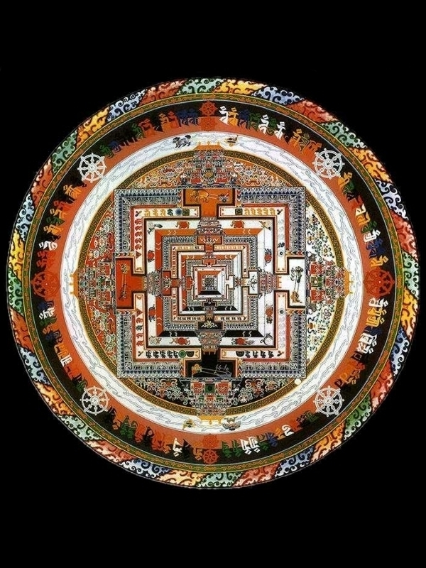 Depiction of a sand mandala, a circle with an ornate geometric pattern inside of it. The pattern is made from colored sand.