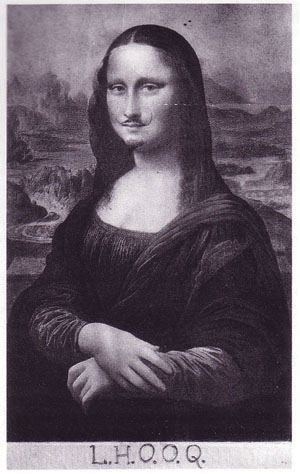 Black and white postcard reproduction of the famous Italian Renaissance portrait The Mona Lisa. A mustache has been drawn on the subject's upper lip. The letters LHOOQ are hand-written along the bottom of the card.