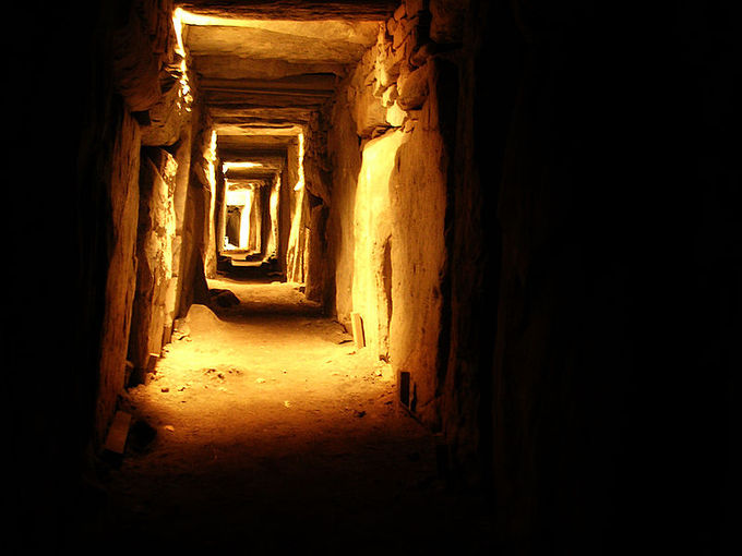 Photograph of the view looking into the Eastern Passage. It resembles a dark corridor with cracks that let in sunlight.
