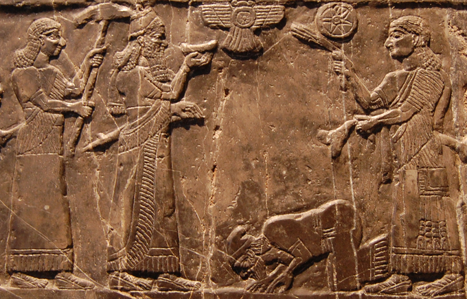 Photo shows detail view of a scene from the black limestone Assyrian sculpture. The Assyrian king Shalmaneser III receives tribute from Sua, king of Gilzanu, The Black Obelisk.