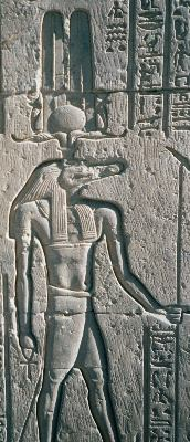 Relief depicts a man's body with the head of a crocodile clad in pharaoh's headdress. The man's body is muscular. He is shirtless and wearing a loincloth.