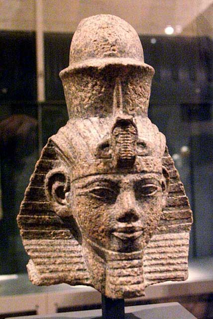 Sculpture depicts the head of Amenhotep the Magnificent, an Egyptian pharaoh. He wears a pharaoh's crown.