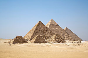 Photo depicts three pyramid structures.