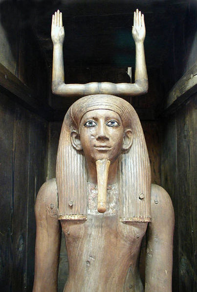 Statue depicts the pharaoh Hor from the waist up. Behind him, two upraised arms top his head, forming the hieroglyphic sign for his name.