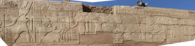 Photograph depicts frieze decorated with reliefs.