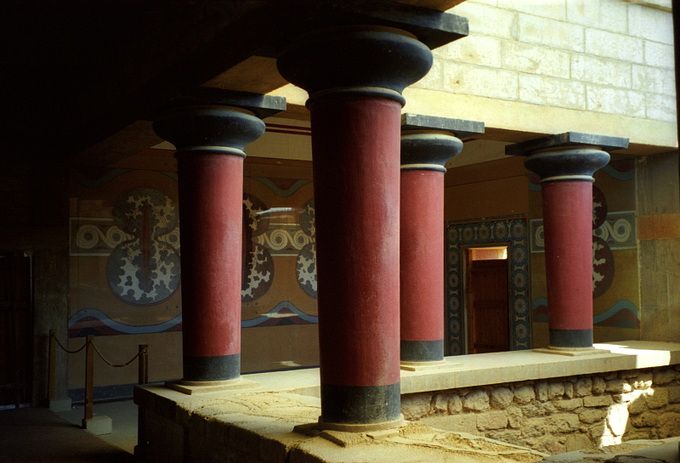 This is a color photograph of the restored interior stairwell at the palace at Knossos, Crete, Greece.