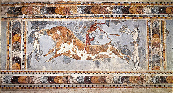 This is a color photograph of Bull Leaping, a fresco found on an upper story of the palace at Knossos, Crete, Greece. Circa 1450–1400 BCE. On either side of the leaping bull are human figures.