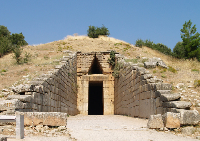 This is a color photo of the Treasury of Atreus, Mycenae, Greece, circa 1300–1250 BCE. The Treasury of Atreus and others tombs like it are demonstrations of corbeled vaulting that covers an expansive open space.