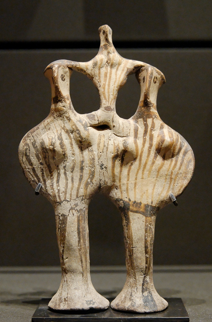 This is a color photograph of a Mycenaean phi figure. These figures are named for their shape, which resembles that of the Greek letters phi.