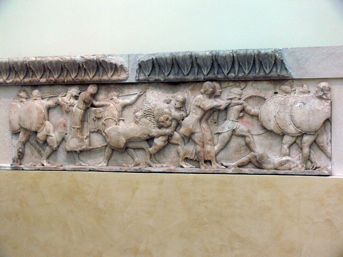 This is a photo of the north frieze of the Siphnian Treasury in Delphi, Greece. It depicts a struggle between the giants and gods.
