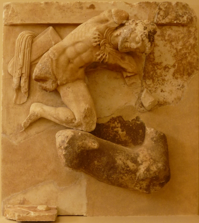 This is a photo from the Treasury of Athens at Delphi, Greece. It is a metope that shows Herakles catching the Ceryean Hind (the hind end of Diana's pet deer).