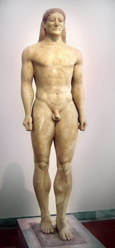Color photo of a nude free-standing male sculpture. The face bears a slight smile.