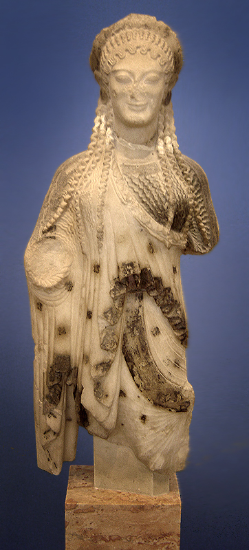 This is a photo of the Acropolis Kore statue, which depicts a woman wearing a one-shouldered draped garment and a draped cloak.