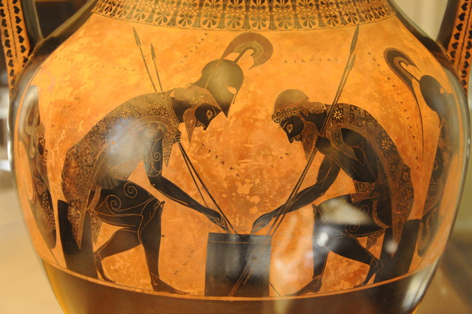 This is a photo of pottery decorated with a scene of Achilles and Ajax playing a game in their war armor.