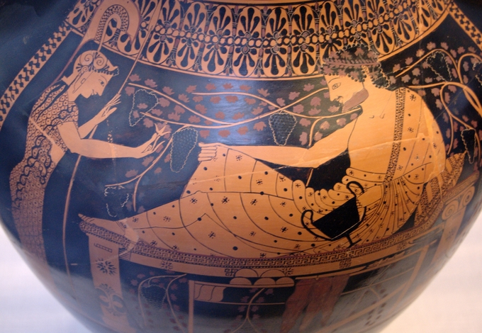 This is a color photo of pottery decorated with a scene depicting Herakles and Athena in the red figure style.