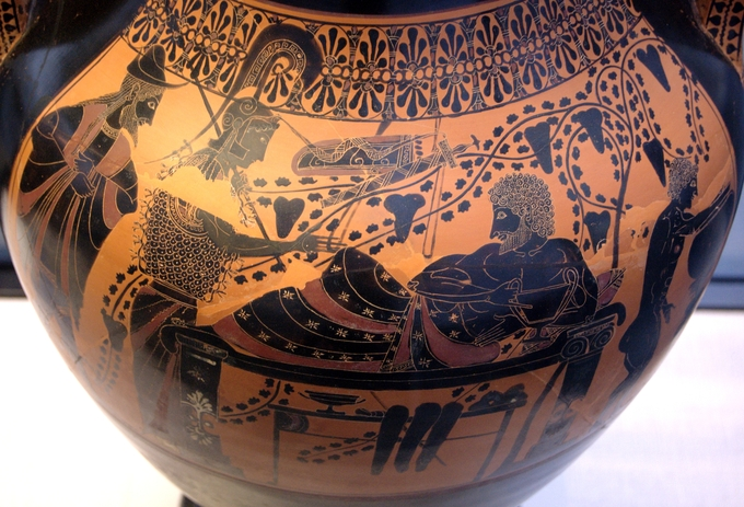This is a color photo of pottery decorated with a scene of Herakles and Athena in the black figure style.