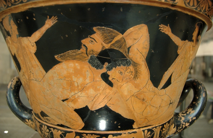 This is a photo of Herakles Wrestling Antaios. It is a piece of Greek pottery depicting a wrestling contest between Herakles and Antaios.