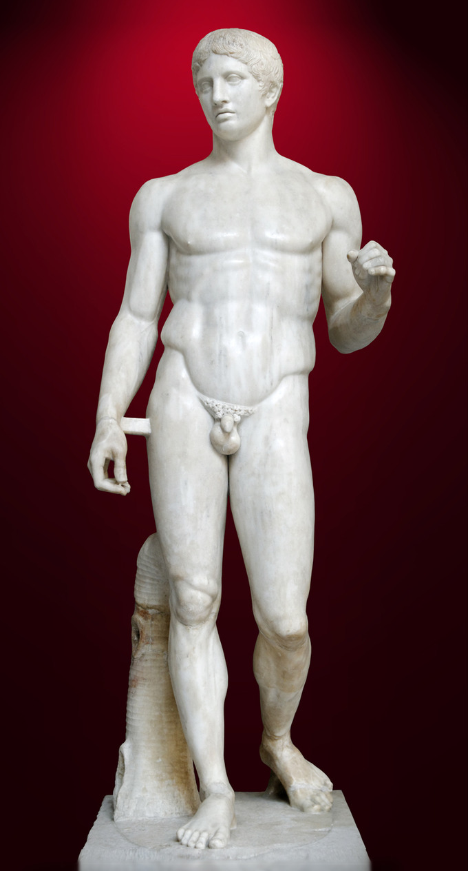 This is a color photo of Polykleitos's Doryphoros, or Spear Bearer, a statue of a nude male with chiseled abdominal and upper body muscles.