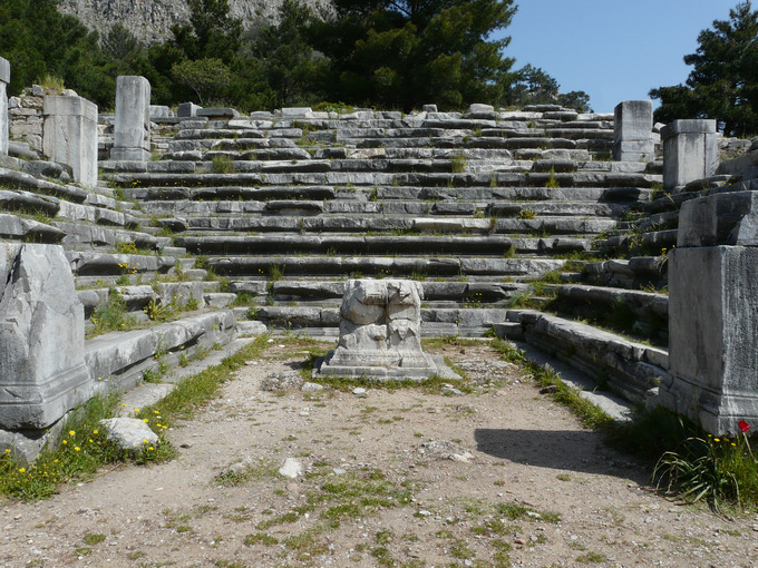 This is a current-day photo of a bouleuterion. It shows the ruins of the tiered seating arrangement common to this structure.