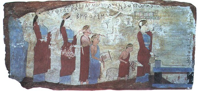 Painted wood panel depicting a sacrifice to the nymphs. Three or more women, dressed in chiton and peplos, are approaching an altar to the right. They are accompanied by musicians. The person nearest the altar appears to be pouring something from a jug. The person behind her leads the sacrifice: a small lamb.