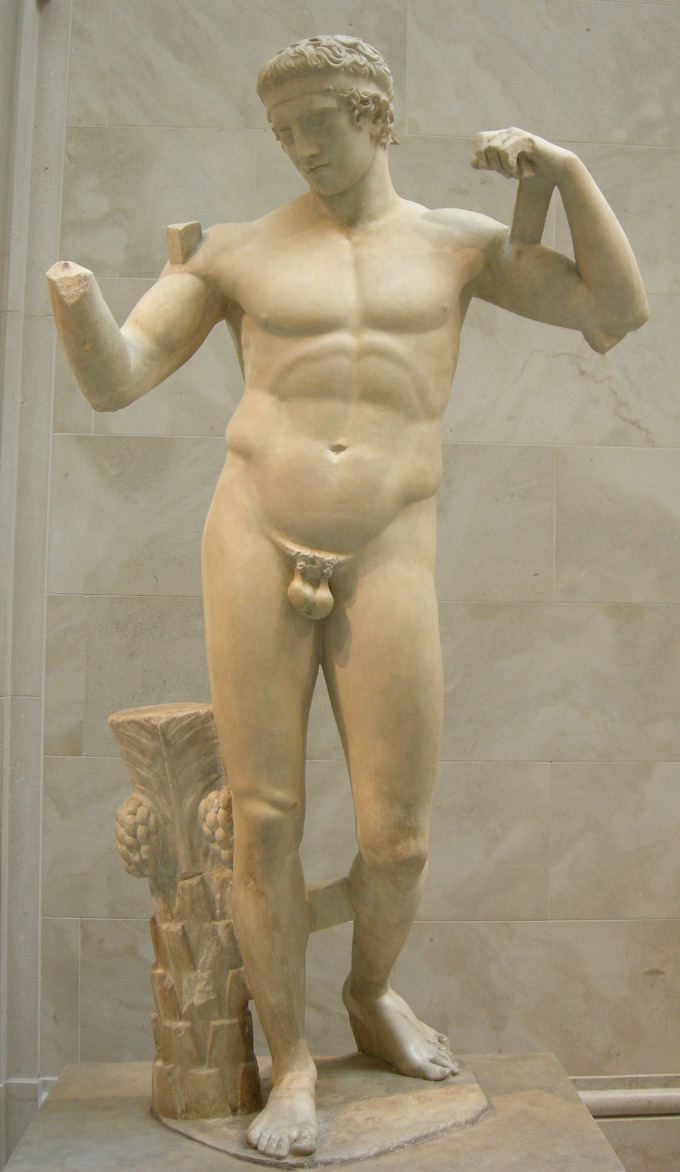 This is a photo of the statue of Diadoumenos. It is a marble statue depicting a nude male with idealized musculature.