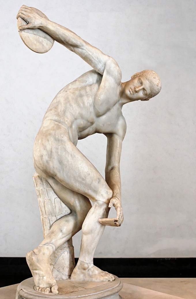 This is a photo of Diskobols. It is a statue of a male figure preparing to throw the disk in his hand.