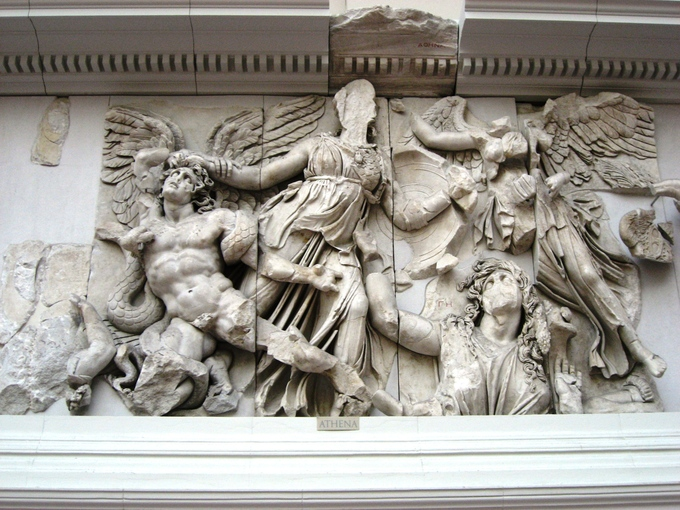 This is a photo of the frieze depicting Athena and Alkyoneos. Athena grabs the hair of the giant Alkyoneos as Nike flies to crown her.