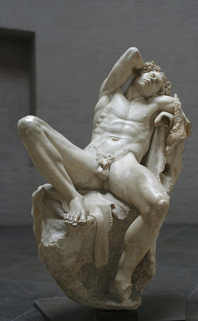This is a photo of the statue the Barberini Faun. It depicts a nude male, seated with his legs spread and his arm behind his head.
