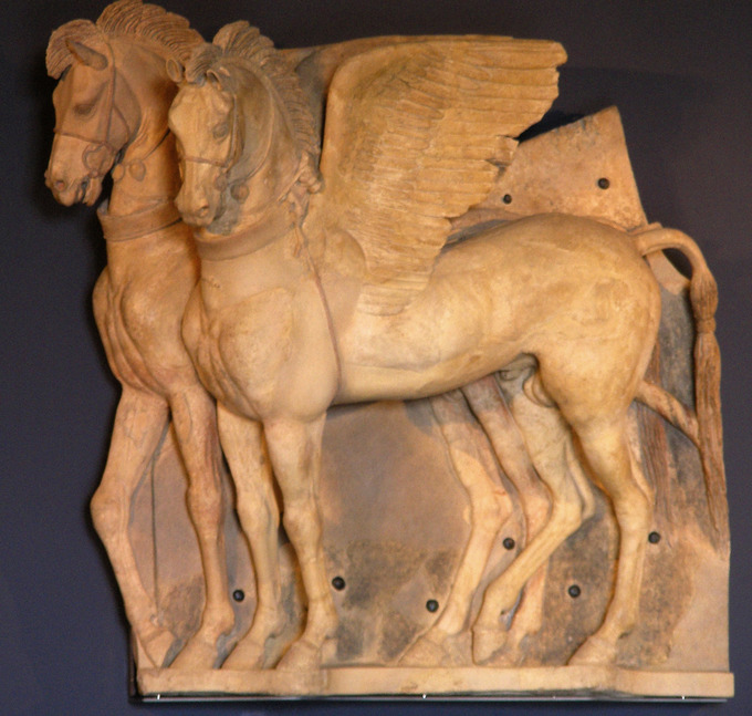 This is a photo of the terra cotta statue Winged Horses, which features two detailed winged horses standing side by side.