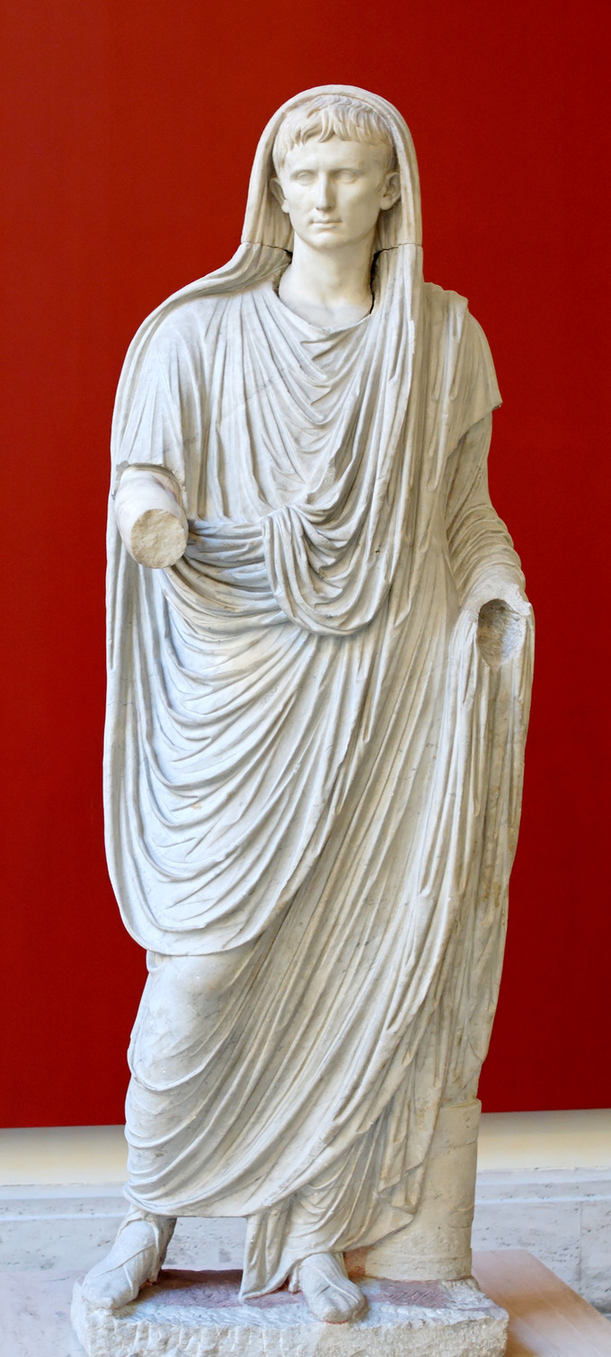 This photo shows a statue of Augustus portrayed as Pontifex Maximus, dressed in a toga that covers his head.