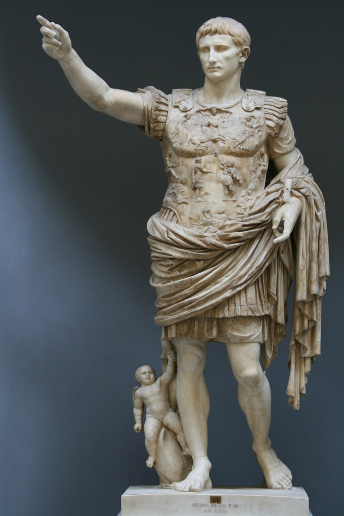 This photo shows the Augustus of Primaporta statue. He solutes the army in a contrapposto stance wearing a breastplate and battle garb.