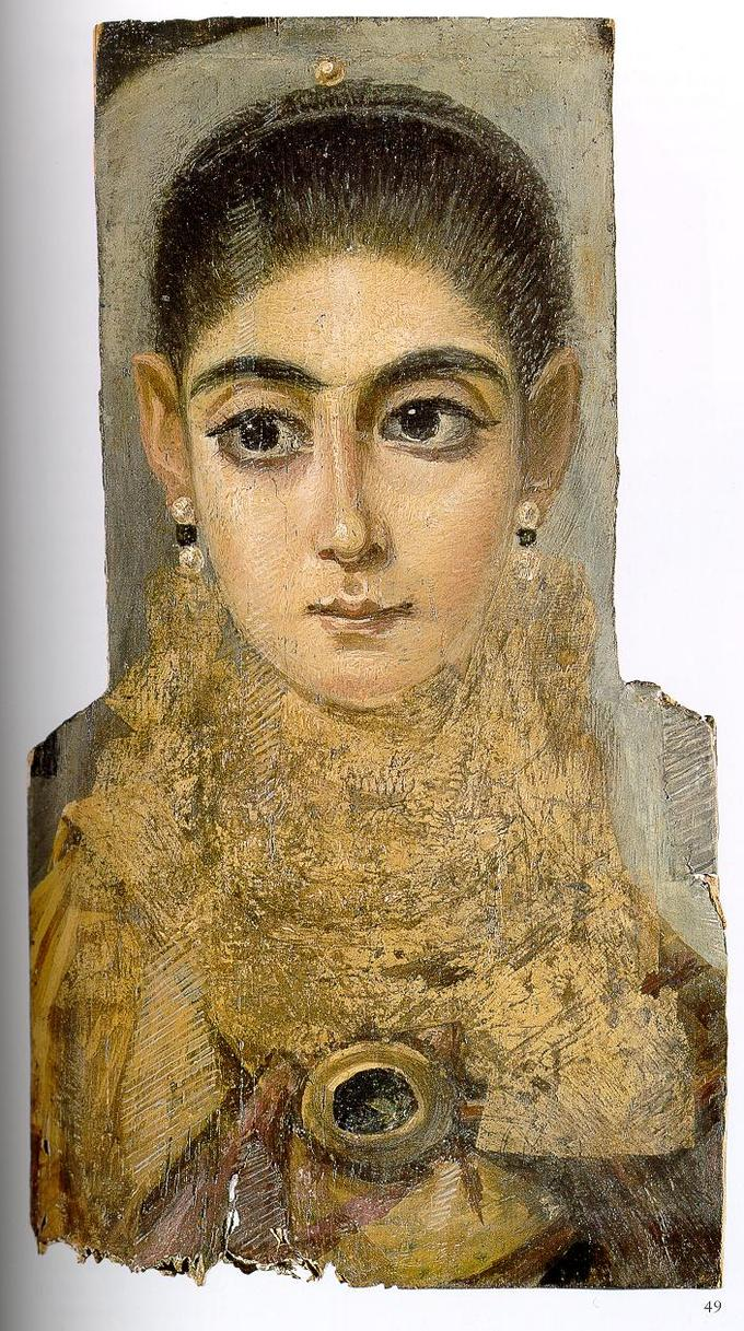 This photo shows a mummy portrait of a young woman. She has dark hair pulled back from her face, prominent dark eyebrows, and large defined eyes. Her nose is narrow and thin and her lips are small in proportion to her face. She wears earrings and a high gold-colored collar.