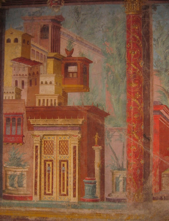 This photo shows a detail from a second-style wall painting in the villa of P. Fannius Synistor. It demonstrates the technique of architectural details painted to resemble real ones, such as rustic masonry, pillars, and columns.