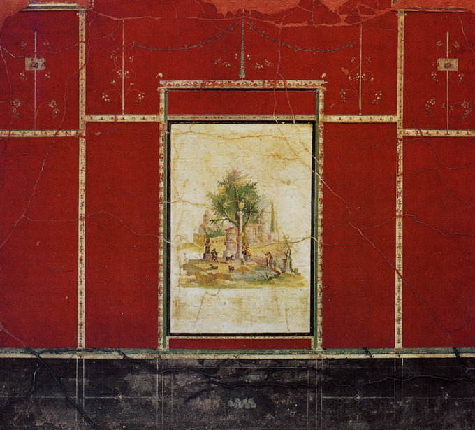 This photo shows a detail of a Third-Style wall painting. It demonstrates the technique of embracing the flat surface of the wall through the use of broad, monochromatic planes of color punctuated by intricately painted architectural details. In this case, the wall is red and details like a candelabra and faux moulding are painted in a lighter neutral color.