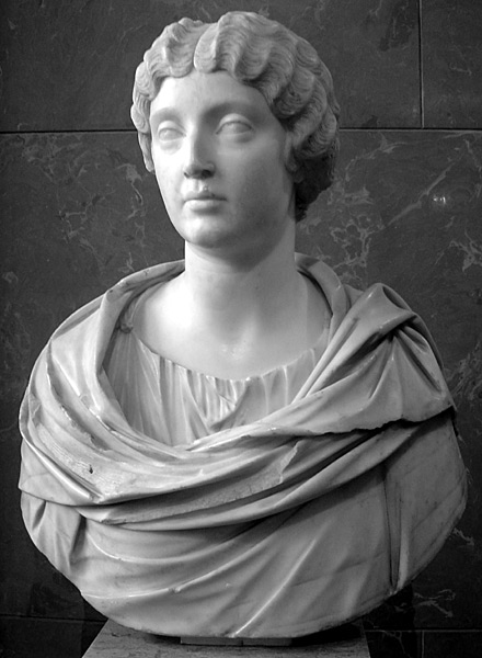 This photo shows a bust of Faustina the Younger, depicting hair parted in the middle and carefully crimped close to the head.