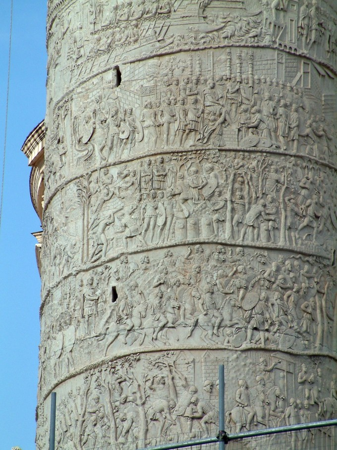 This is a closeup photo of five registers or bands from the Column of Trajan. Each band portrays scenes from Trajan's two victorious military campaigns against the Dacians.