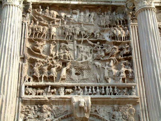 Photograph shows a panel relief between two flutes columns.
