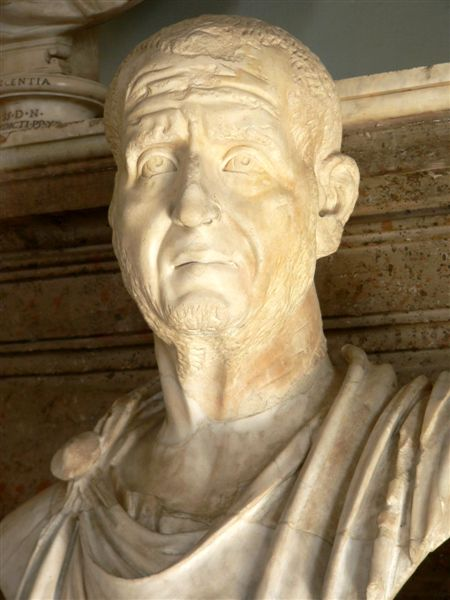 This is a photo of the portrait of Trajanus Decius, a man with a receding hairline and a lined face. His expression shows that he is anxious and concerned.