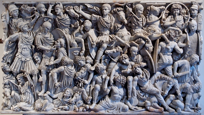 This is a closeup photo of the Ludovisi Sarcophagus. The panel relief depicts a densely populated Roman battle scene.
