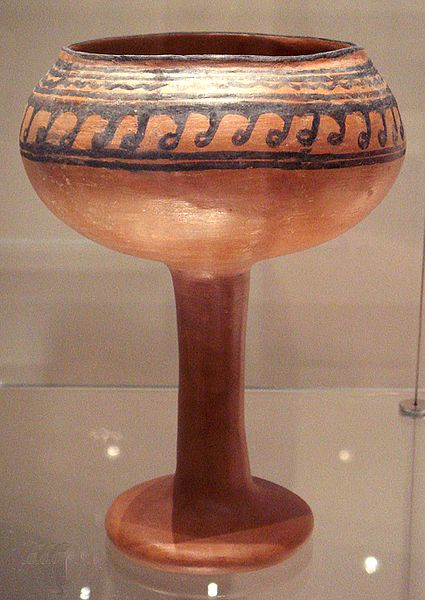 This photo shows a goblet from Navdatoli, Malwa. It is red with a black abstract design along the rim.